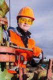 Donna nel giacimento di petrolio Fotografia Stock
