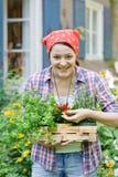 Donna nel giardino Fotografie Stock Libere da Diritti