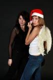 Donna nel nero e donna con le ali Fotografie Stock