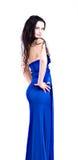 Donna nel posgin blu del vestito con l'espressione Immagini Stock