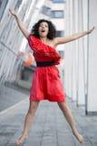 Donna nel salto rosso del vestito Immagine Stock Libera da Diritti