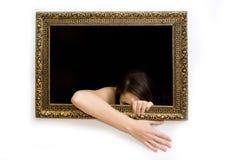 Donna nel telaio della pittura fotografia stock