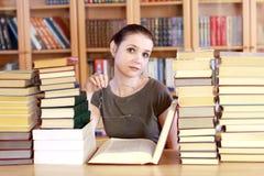 Donna nella libreria Fotografie Stock