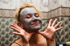 Donna nella mascherina Fotografia Stock