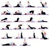 Donna nelle posizioni di yoga Fotografia Stock Libera da Diritti