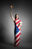 Donna nello stile della statua della libertà Fotografia Stock