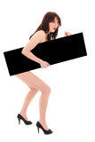 Donna nuda stupita con il tabellone per le affissioni nero Fotografie Stock Libere da Diritti