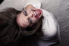 Donna pazzesca di grido Immagine Stock