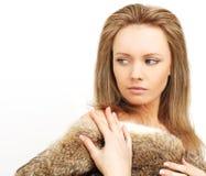 Donna in pelliccia, passione repressa Fotografie Stock Libere da Diritti