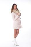 donna in pelliccia su una priorità bassa bianca. Immagine Stock