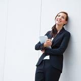 Donna Pensive di affari con il ridurre in pani Fotografie Stock