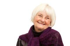 Donna più anziana di risata su priorità bassa bianca Fotografia Stock