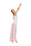 Donna in pigiami che fanno esercizio di mattina Immagini Stock