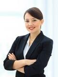 Donna positiva di affari che sorride sopra il bianco fotografia stock