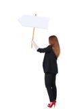 Donna posteriore di affari di vista che mostra il bordo del segno Immagini Stock
