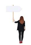 Donna posteriore di affari di vista che mostra il bordo del segno Immagini Stock Libere da Diritti