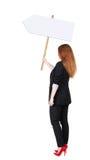 Donna posteriore di affari di vista che mostra il bordo del segno Immagine Stock