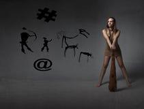 Donna preistorica con il club Fotografia Stock