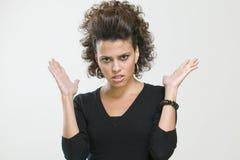 Donna preoccupata che fa gesto con le sue mani Immagini Stock
