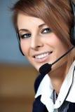Donna rappresentativa della call center con la cuffia avricolare. Immagine Stock