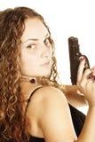 Donna riccia con la pistola immagini stock libere da diritti