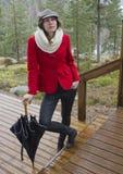 Donna in rivestimento rosso Fotografia Stock