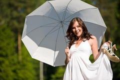 Donna romantica felice con il parasole nel sunglight Fotografia Stock Libera da Diritti