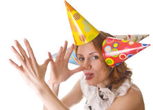 Donna scherzosa in cappelli del partito Immagine Stock