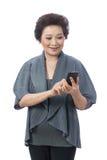 Donna senior asiatica isolata su bianco Fotografie Stock Libere da Diritti