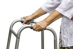 Donna senior che usando un camminatore Immagini Stock Libere da Diritti