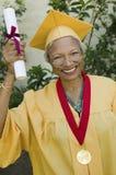 Donna senior con il grado e la medaglia Fotografie Stock Libere da Diritti
