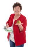 Donna senior isolata con soldi ed oro: concetto per la pensione a fotografia stock libera da diritti