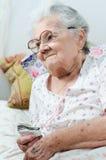 Donna senior malata Fotografia Stock