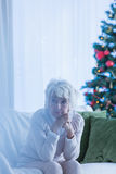 Donna senior sola al Natale Fotografia Stock Libera da Diritti