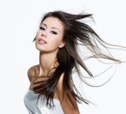 Donna sensuale con i bei capelli marroni lunghi Fotografie Stock