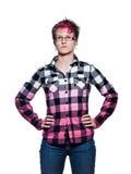 Donna seria che sta con le armi sulla vita Fotografie Stock Libere da Diritti