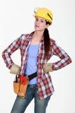 Donna seria con gli strumenti Fotografie Stock