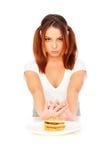 Donna seria con l'hamburger Fotografia Stock Libera da Diritti