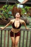 Donna sexy attiva nel movimento Immagine Stock
