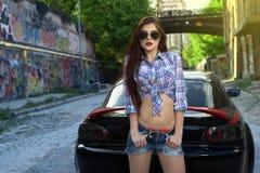 Donna sexy che conduce un'automobile fotografia stock libera da diritti