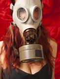 Donna sexy con la maschera antigas Fotografia Stock
