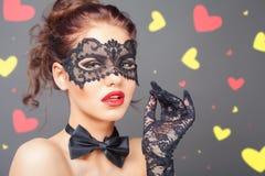 Donna sexy con la maschera di carnevale Fotografie Stock