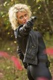 Donna sexy con la pistola del silenziatore Fotografia Stock