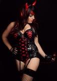 Donna sexy in costume del diavolo Fotografia Stock