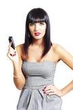 Donna sexy del brunette con un telefono delle cellule Fotografia Stock