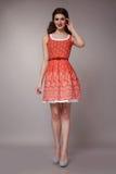Donna sexy di affari di bellezza nell'ente esile perfetto del vestito da modo Fotografie Stock