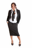 Donna sicura di affari che si leva in piedi nel vestito nero Fotografie Stock Libere da Diritti