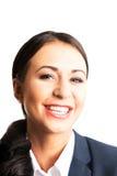 Donna sicura di affari che sorride alla macchina fotografica Fotografia Stock