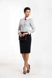Donna sicura in vestito di affari in ufficio Fotografie Stock