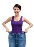 Donna snella che porta i jeans enormi Fotografia Stock Libera da Diritti